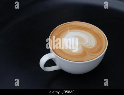 Latte art coffee. Heart shape latter art in white cup - Stock Photo