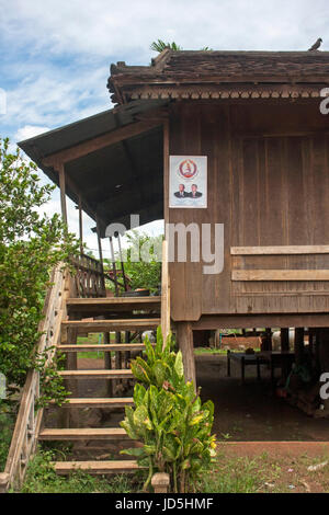 A stilted wooden house is part of the village landscape in Chork village, Tboung Khmum Province, Cambodia. - Stock Photo