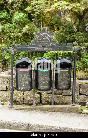 Funny shaped recycling garbage bins in Aguas calientes,Cusco, Peru - Stock Photo