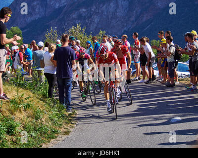 MONTVERNIER, FRANCE - JULY 23 2015: riders in a road turn with spectators on stage 18 in Tour de France 2015 - Stock Photo