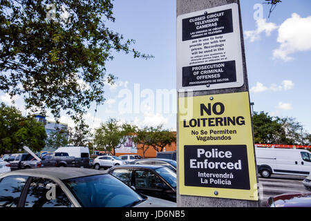 Miami Florida Little Havana Home Depo parking lot sign no loitering bilingual Spanish English language no homeless - Stock Photo