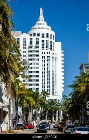 Miami Beach Florida Loews Hotel resort tower high rise landmark building exterior luxury hotel palm trees view street - Stock Photo