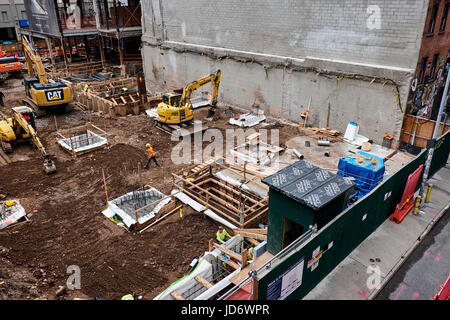 NEW YORK CITY - SEPTEMBER 28, 2016: Building site in the Chelsea area where excavators are working on soil above - Stock Photo
