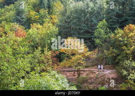 Thueyts, France, september 11, 2016:  Older man and woman enjoy the view along the river Ardeche - Stock Photo