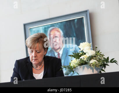 Berlin, Germany. 18th June, 2017. German Chancellor Angela Merkel signs the condolences book for former German Chancellor - Stock Photo