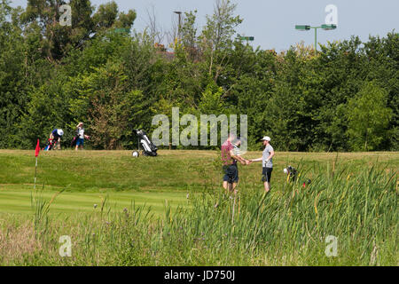 London. UK 18 June 2017 - Golfers playing golf on Sunday morning in London Golf Centre, South London on the hottest - Stock Photo