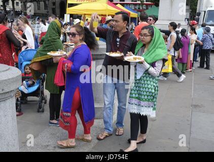 London, UK. 18th June, 2017. Pilgrims enjoying free food at London Rathayatra Credit: Maji Murrell/Alamy Live News - Stock Photo