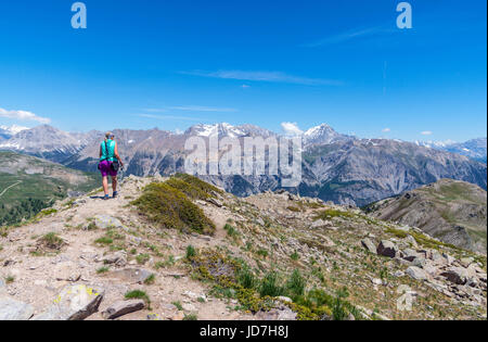 Solitary female walker and Panorama from Le Grand Meyret above the Col de Granon, Briancon, Ecrins, France - Stock Photo