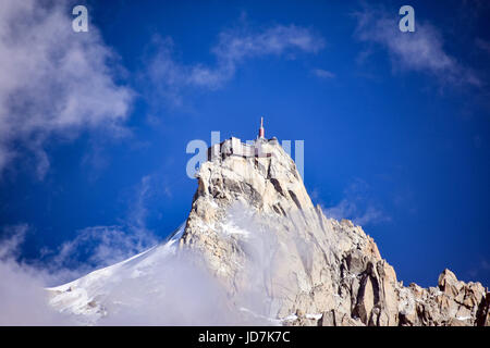 Aiguille du Midi cable-car station in the clouds, Chamonix, France - Stock Photo