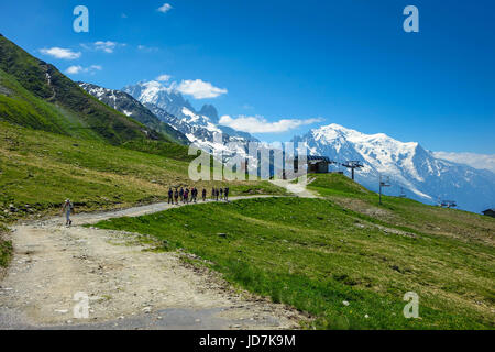 Group of hikers leaving the Col de Balme cable-car, Chamonix Mont Blanc - Stock Photo
