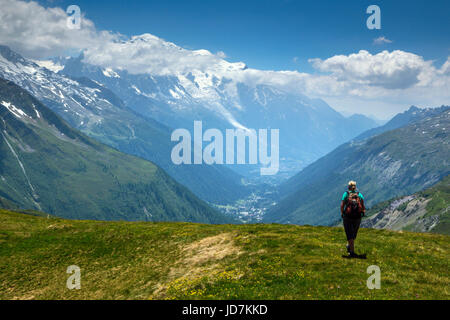 Lone female walker high above Chamonix Valley - Stock Photo