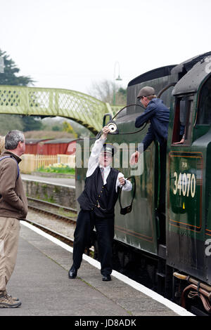 The train driver and station master at Corfe Castle on the Swanage Railway, Dorset, England - Stock Photo