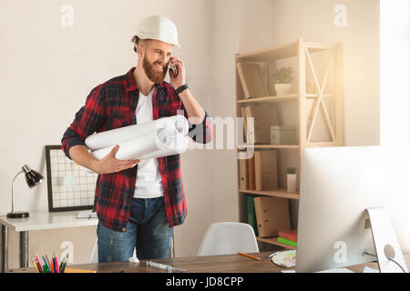 Young male architect working indoors draft blueprint - Stock Photo