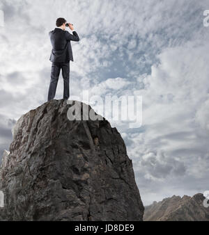Businessman searchs for new horizon, new business opportunities - Stock Photo