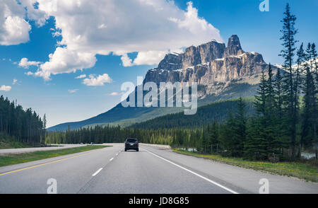 View from a car of Trans-Canada highway going through Alberta's Rockies in Banff Provincial Park. Rocky Mountains, - Stock Photo
