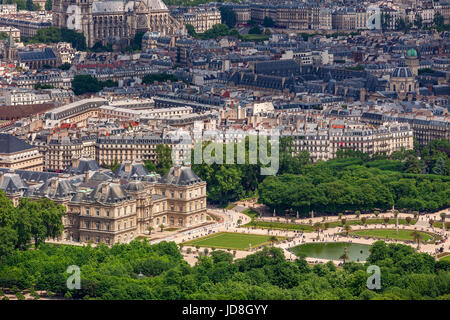 View from above on famous garden Jardin du Luxembourg and  Luxembourg Palace as typical parisian buildings on background - Stock Photo