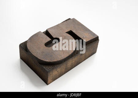Old letterpress number five printing block isolated on a white background - Stock Photo