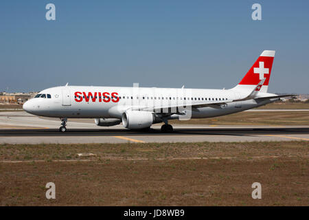 Commercial air transport. Swiss International Air Lines Airbus A320 airliner taxiing for departure from Malta - Stock Photo