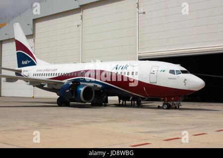 Commercial aviation. Boeing 737-700 passenger jet aeroplane of Nigerian airline Arik Air undergoing maintenance - Stock Photo