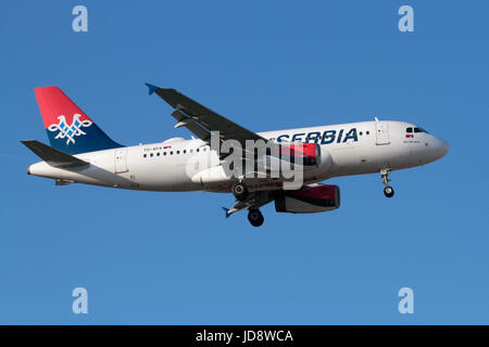 Commercial air travel. Air Serbia Airbus A319 narrowbody airliner on final approach - Stock Photo