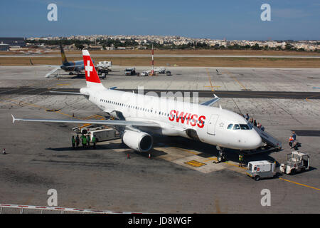 Commercial air travel in Europe. Passengers boarding a Swiss International Air Lines Airbus A320 jet plane on the - Stock Photo