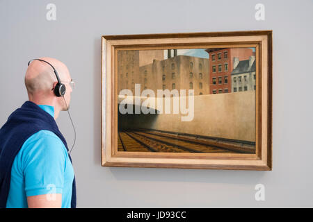 Man looking at painting  Approaching a City by Edward Hopper, at exhibition of American art , From Hopper to Rothko - Stock Photo