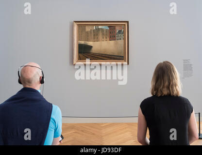 Visitors looking at painting  Approaching a City by Edward Hopper, at exhibition of American art , From Hopper to - Stock Photo