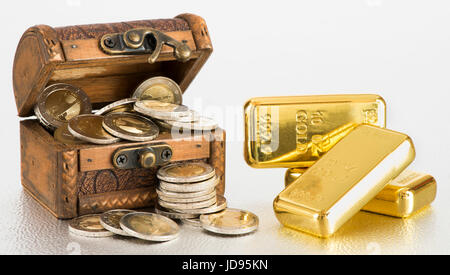 treasure chest with gold bars and euro coins