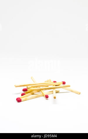 Scattered matches on White Background - Stock Photo