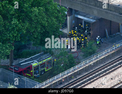 Firemen under the burning Grenfell Tower in North Kensington attempt to stop the blaze - Stock Photo