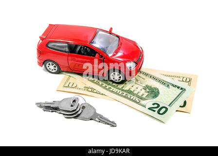 Red toy car with keys and money isolated on white - Stock Photo