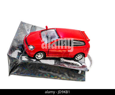 Toy car on gift packet isolated - Stock Photo