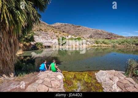 Young boys at pond at Rogers Spring, geothermal hot spring oasis near Northshore Road, Lake Mead National Recreation - Stock Photo