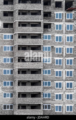 Under construction high-rise apartment building in a residential area of the city - Stock Photo