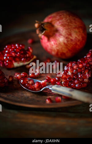 Red juice pomegranate on vintage background - Stock Photo
