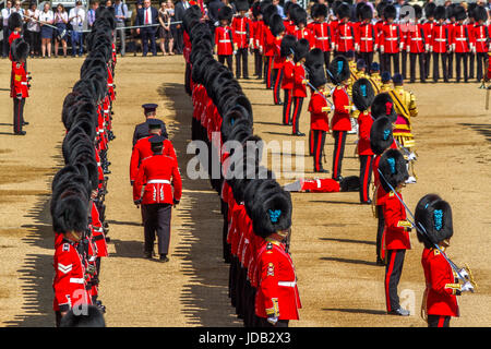 Soldier faints in extreme heat and is rescued by stretcher bearers at The Queens Birthday Parade,Trooping The Colour, - Stock Photo