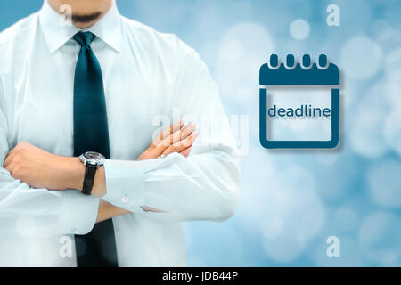 Deadline concept. Businessman silhouette in bacground. Manager thinks about upcoming project deadline. - Stock Photo