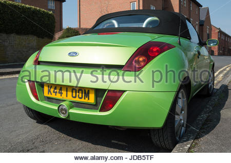 Bright green Ford convertible Streetka parked by a double yellow line, Sturminster Newton, Dorset, England - Stock Photo