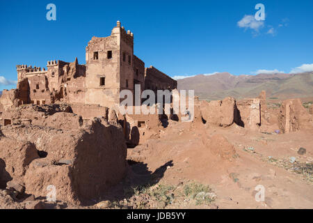The walls of an abandoned fort in Telouet slowly crumble and decay back into the surrounding desert - Stock Photo