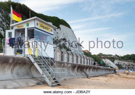 Lifeguard station and beach huts on Stone Bay beach, Broadstairs, Kent, England UK - Stock Photo