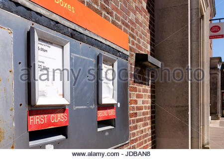 First and second class post boxes outside the Post Office, Blandford Forum, Dorset, England UK - Stock Photo
