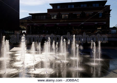 Sundown by the fountains in the Brewery Square redevelopment, Dorchester, Dorset England UK - Stock Photo
