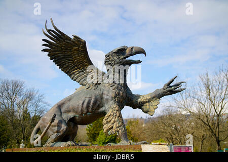 Griffin statue in a cemetery - Stock Photo