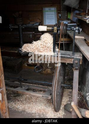 Wood turning at the Latvian Ethnographic Open-Air Museum, Lake Jugla, Riga, Latvia. - Stock Photo
