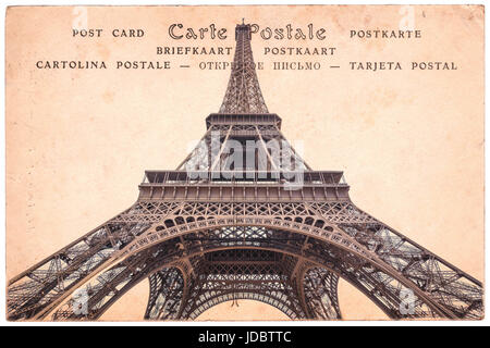 Eiffel tower in Paris, France, collage on sepia vintage postcard background, word 'postcard' written in several - Stock Photo