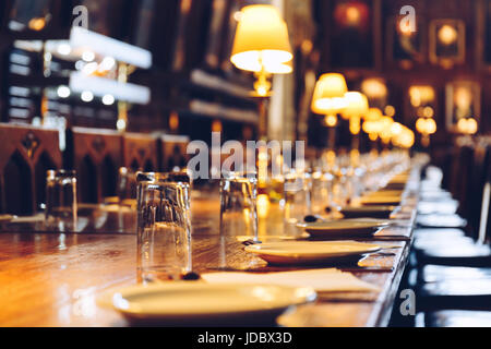 Table set at The Great Hall of Christ Church, University of Oxford, England. The Hall was replicated at film studios - Stock Photo
