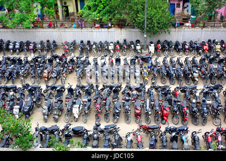 Top view of two wheeler vehicles parking in which motor bikes and  scooters arranged in proper way in rows - Stock Photo