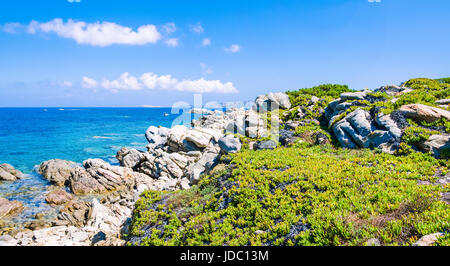 Granite rocks coastline and amazing azure water on beautiful Sardinia island near Porto Pollo, Sargedna, Italy. - Stock Photo