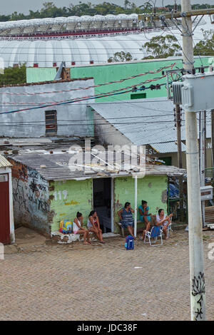 Local residents outside their home in the Santa Tereza neighbourhood of Porto Alegre, state of Rio Grande do Sul, - Stock Photo