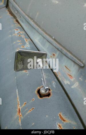 Close up detail of rusty decayed Morris Minor motor vehicles, UK - Stock Photo